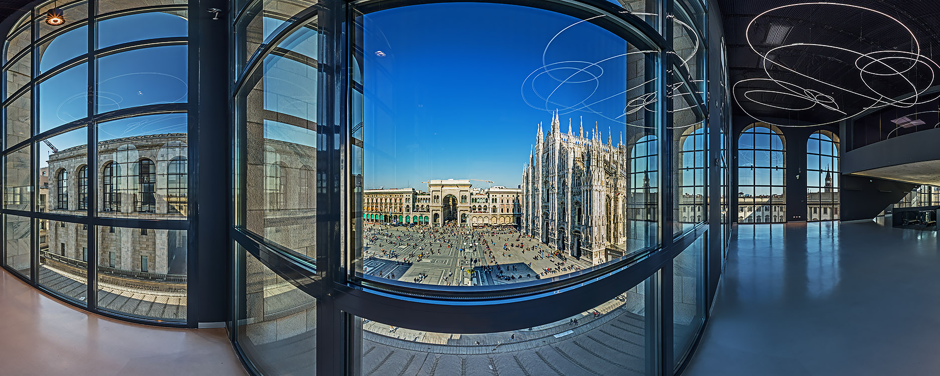 The nice view on Piazza del Duomo and the Lucio Fontana Neon Sculpture