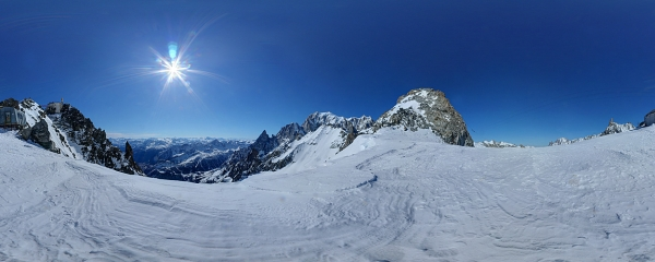 Mont Blanc and some tops of the mountain range seen from the Helbronner Point glacier above Courmayeur